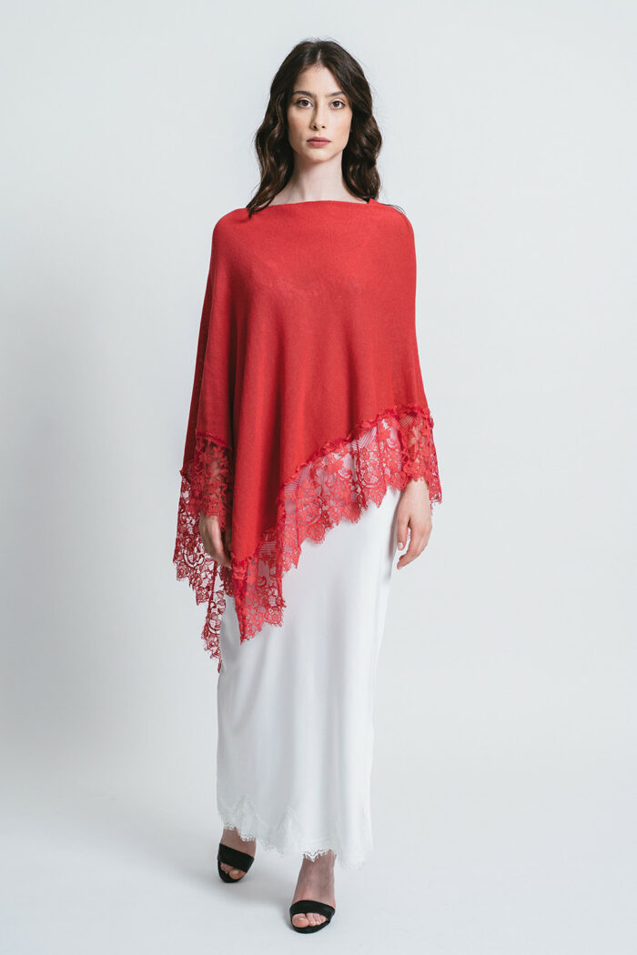 Poncho with lace border