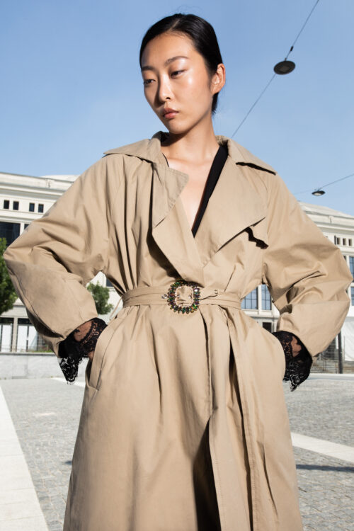 Trench coat with lace and jewel buckle